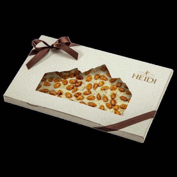 Produktabbildung_HEIDI weiße Schokolade mit Mandeln, Orange und Pistazien in Geschenkverpackung